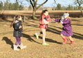 Kids girls playing blind man s buff young in winter clothes happy a game Stock Photos