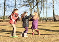 Kids girls playing blind man s buff young in winter clothes happy a game Stock Image
