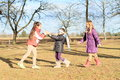 Kids girls playing blind man s buff young in winter clothes happy a game Stock Images