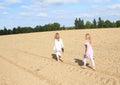Kids - girls walking on field Royalty Free Stock Photo