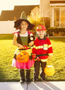 Kids going trick or treating on halloween two cute in costumes Royalty Free Stock Photo