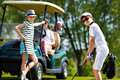 Kids golf competition children playing and taking part on in course at summer day Stock Images