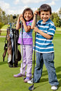 Kids at a golf field Royalty Free Stock Photo