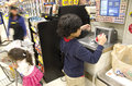 Kids grocery shopping were checking out at store Stock Photo