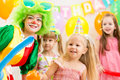 Kids group on birthday party and clown Royalty Free Stock Photography