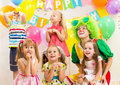Kids group on birthday party jolly and clown Stock Photo