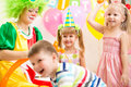 Kids group and clown on birthday party jolly Stock Photo