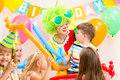 Kids group and clown celebrating birthday party children on Stock Photography