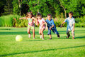 Kids group playing with ball Royalty Free Stock Photo