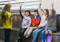 Kids guess what friend shows positive trying to in charades in town Stock Images