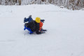 Kids have fun sledding with snow slides Royalty Free Stock Photo