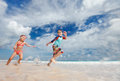 Kids having fun at beach Stock Photography