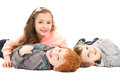 Kids having fun on floor lying together white Royalty Free Stock Photos