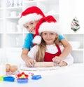 Kids having fun preparing christmas cookies