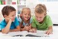 Kids having fun reading Stock Photo