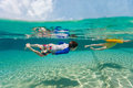 Kids having fun swimming on summer vacation split above and underwater photo of adorable at pool Stock Photo