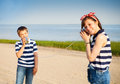 Kids having a phone call with tin cans Royalty Free Stock Photo