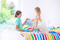 Kids having pillow fight Royalty Free Stock Photo