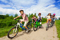 Kids in helmets riding bikes together Royalty Free Stock Photo