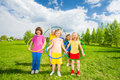 Kids hold hula hoops during exercising activity happy holding at sunny summer day in green park Royalty Free Stock Photo