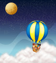 Kids in hot air balloon Stock Images
