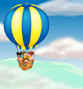 Kids in hot air balloon Stock Photo