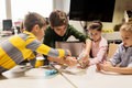 Kids with invention kit at robotics school Royalty Free Stock Photo