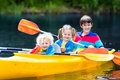 Kids kayaking on a river Royalty Free Stock Photo