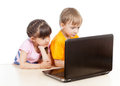 Kids at the laptop girl and boy Stock Photography