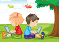 Kids with laptop under a tree Stock Photos