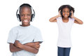Kids listening to music with headphones on a white background Stock Photography
