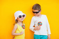 Kids with lollipops adorable little colorful Royalty Free Stock Image