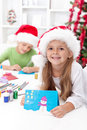 Kids making christmas greeting cards Royalty Free Stock Photo
