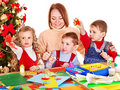 Kids making decoration for Christmas. Royalty Free Stock Images