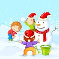 Kids making snowman for christmas vector illustration of Stock Photography