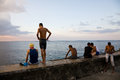 Kids malecon havana a group of young people on the of at sunset cuba Royalty Free Stock Photo