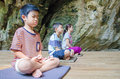 Kids on meditation practise the practice their method in the opened cave Royalty Free Stock Photo