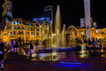 Kids near the fountain in night Royalty Free Stock Photo