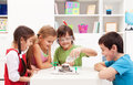 Kids observing a science lab project at home repeating and the baking soda and vinegar volcano Stock Images