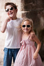 Kids outdoors in city happy brother and sister a Stock Image