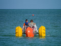 Kids with paddle boat on the ocean two young boys paddling a large off coast of bonita springs florida Stock Photography