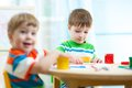 Kids painting in daycare or nursery or playschool Royalty Free Stock Photo