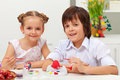 Kids painting easter eggs happy with brushes Stock Image