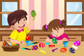 Kids painting easter eggs a vector illustration of at home Stock Photo