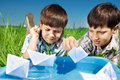 Kids with paper boats Royalty Free Stock Photo