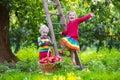 Kids picking apples in fruit garden Royalty Free Stock Photo