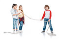 Kids play tug of war Royalty Free Stock Photo