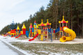 Kids playground site various equipment winter Stock Photography