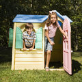 Kids in playhouse. Royalty Free Stock Photo
