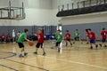 Kids playing basketball match Stock Image